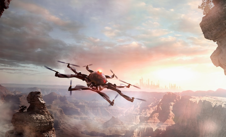 Photo d'un drone survolant les montagnes illustrant l'accentuation de la profondeur et des textures.